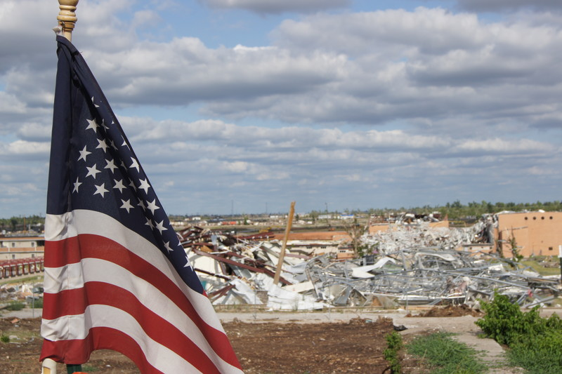 American flag and disaster damage