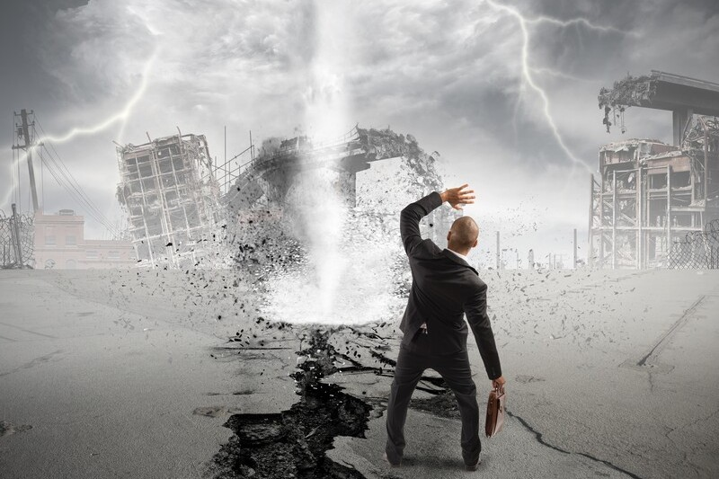 businessman standing in front of tornado