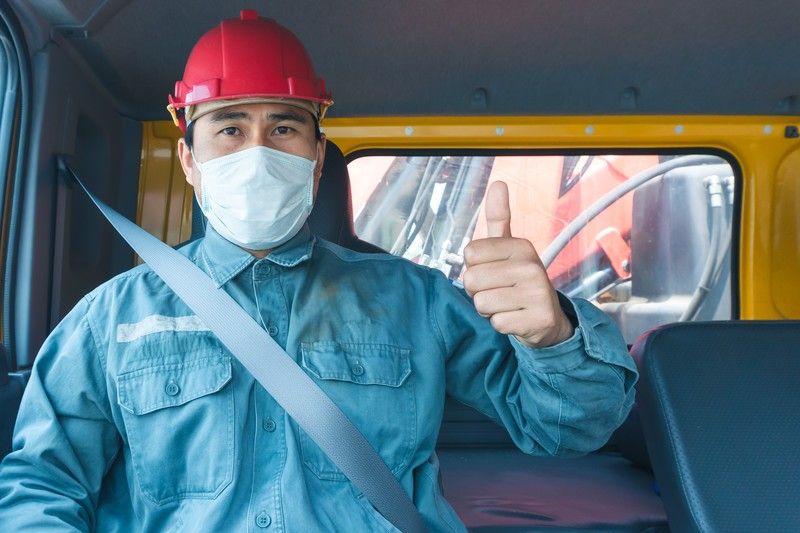 truck driver wearing a medical mask